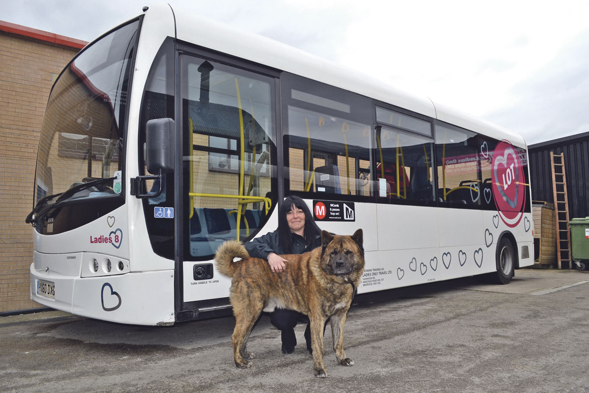 Jeanette and her American Akita in front of one of her 'ladies' – this one being number 8. The hearts 'show we care'
