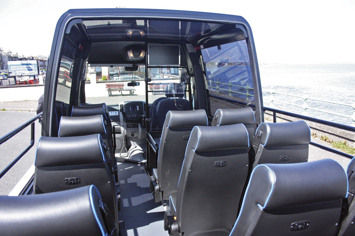 The interior with seating for 16 plus courier