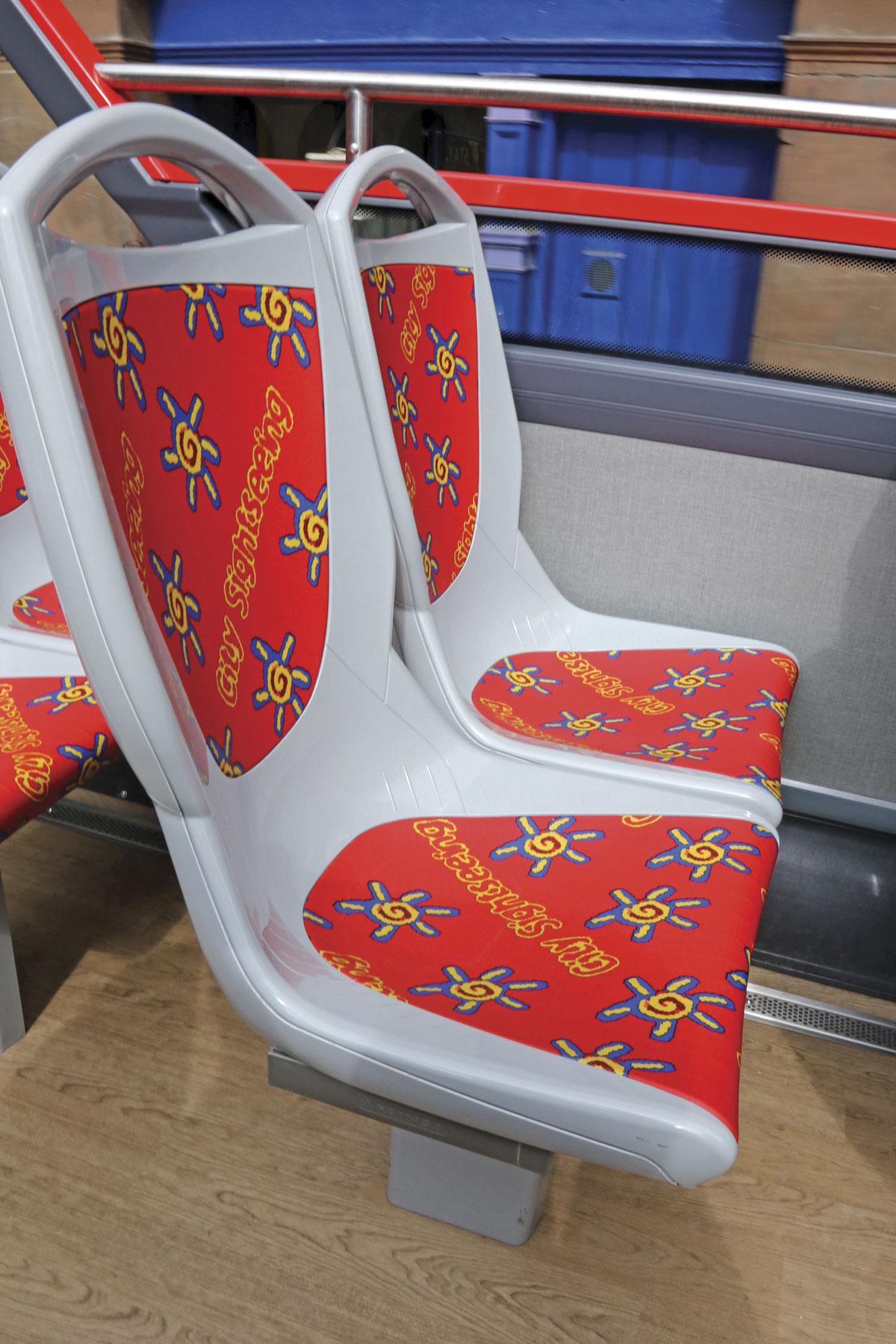 The waterproof Fainsa Metropolis seats from Compin have coloured E-Leather inserts appropriate to the vehicle's tour branding. This is the City Sightseeing version
