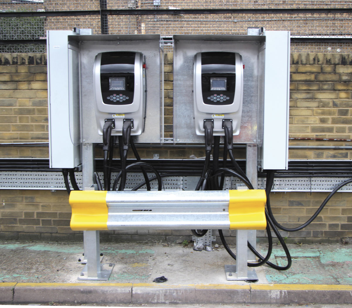 43 of these charging stations have been supplied by BYD and installed at Go-Ahead's Waterloo garage - inset