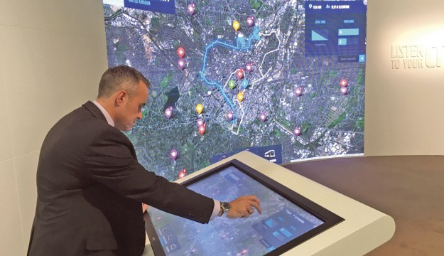 Adrian Felton demonstrates the Volvo City Mobility simulator showing the relative benefits of Volvo's electromobility range in cities across the globe