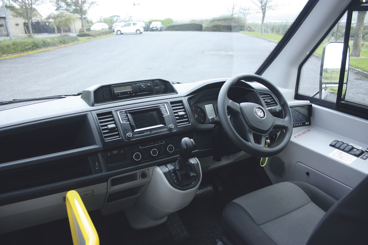 The well laid out cab is largely VW transporter. Note the well integrated body system switches on the driver's right and the reversing camera screen. Vision through the large deep screen is excellent -1
