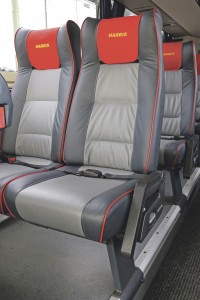 Two tone grey has been used on the seats, with red piping to match the branded headrest covers.