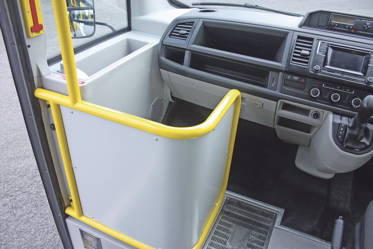Useful storage pocket and luggage pen to the driver's left. Note the floor mounted heater duct