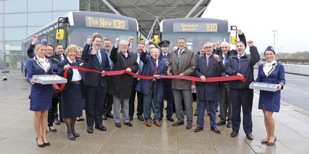 The formal launch with Alex Jones, Managing Director of First Essex, holding the scissors. Neil Banks, Head of Passenger Services at Stansted Airport is to his left and Ray Howard, Essex County Council, Deputy Cabinet Member for Highways and Transport to his right.