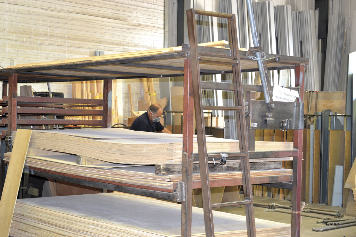 In this section of the workshop, sheets for dry lining and boxing off are machined to size