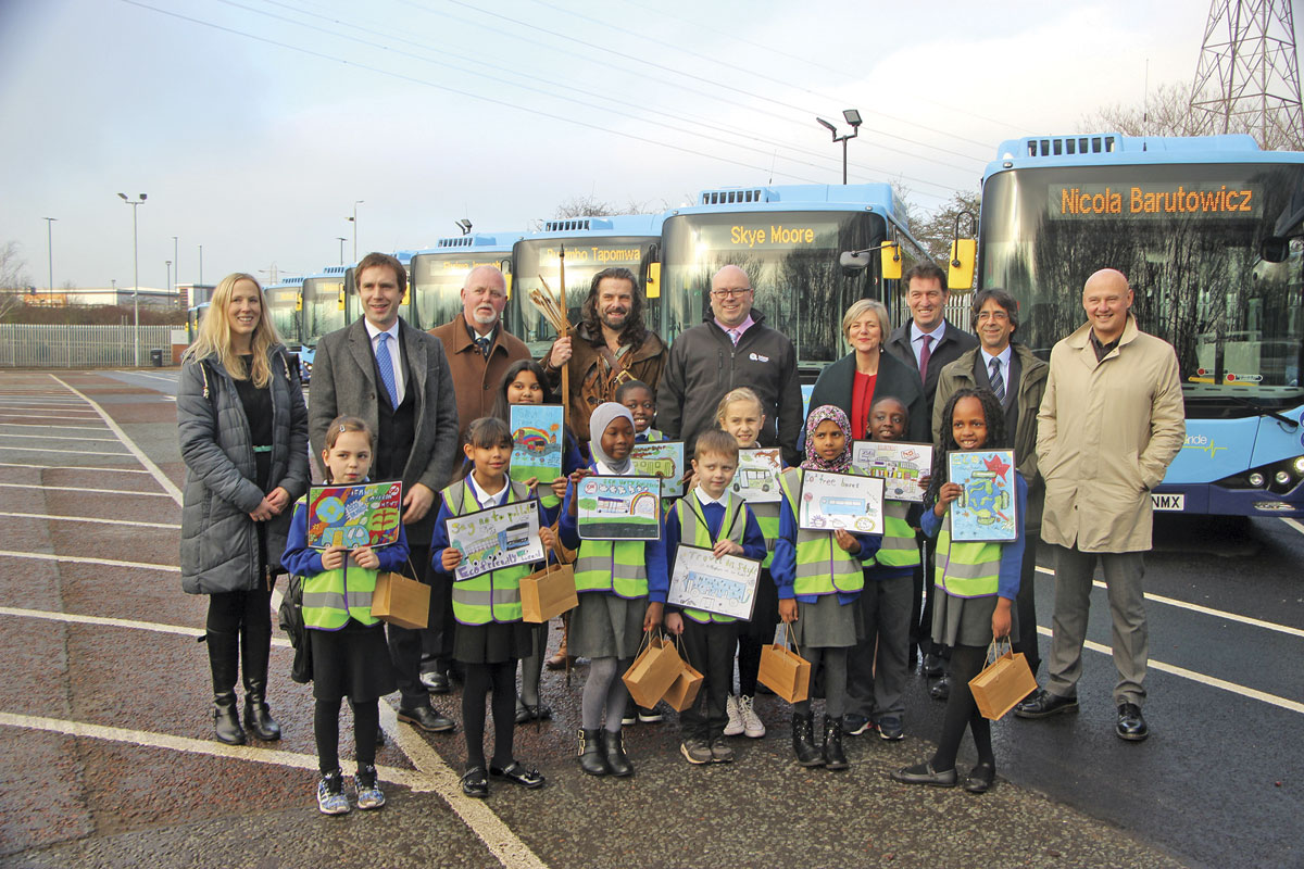 Some of the many stakeholders and the children of Welbeck Primary School in front of the buses