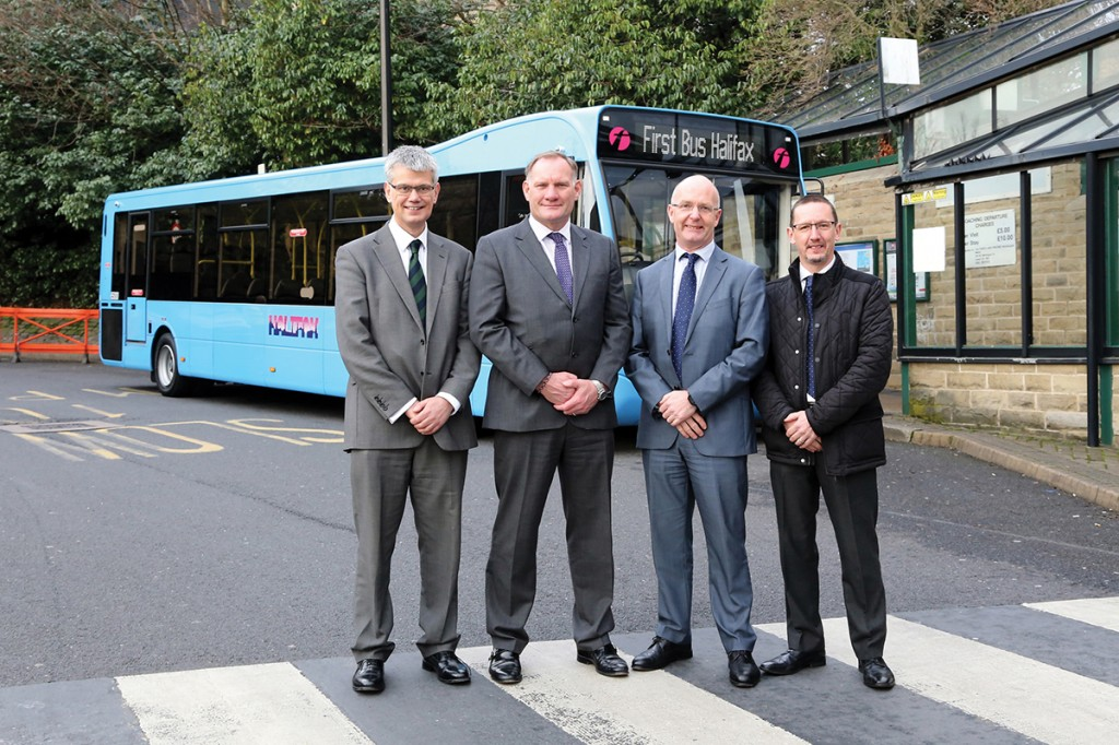 (LtoR) Robert Drewery (Optare), Graham Belgum (Optare), Mark Munday (First Bus) and Mick Campbell (First Bus) mark completion of a successful demonstration partnership in Halifax Bus Station.