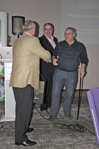 Mick McElhone of Plaxton collects the prize in the Premier Plus champagne draw from Kevin Hull and Chris Clark