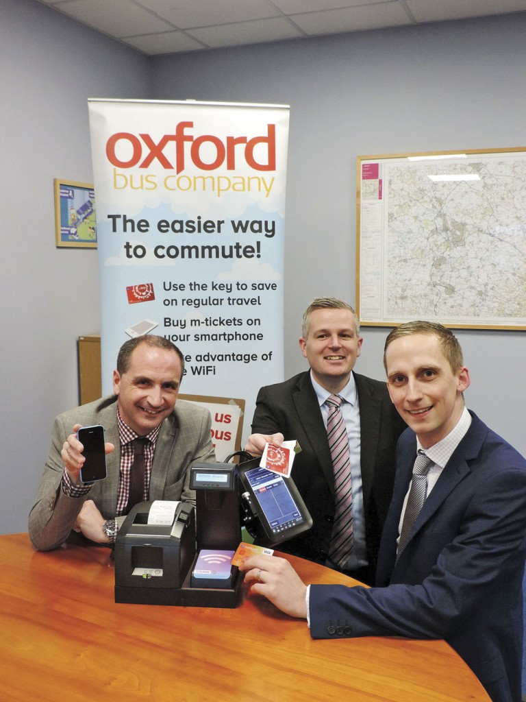Oxford Bus Company's Phil Southall, MD; Andy Morison, Commercial Manager, and Luke Marion, Finance & Commercial Director, with the technology being sourced from Ticketer