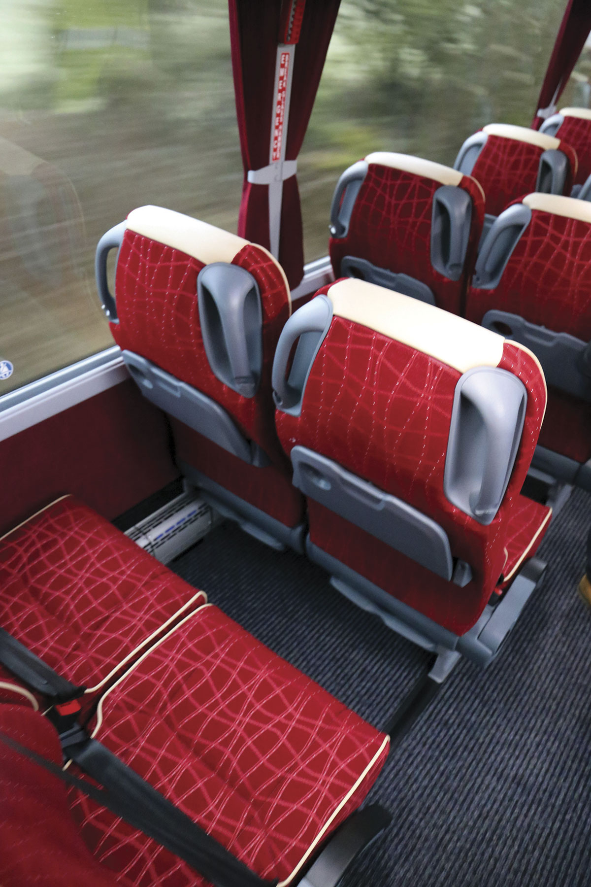 Pulhams specified seatback folding tables. Operators carrying a lot of children can specify half plastic seat backs