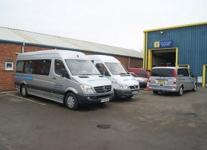 Two of its Mercedes-Benz Sprinter minibuses.