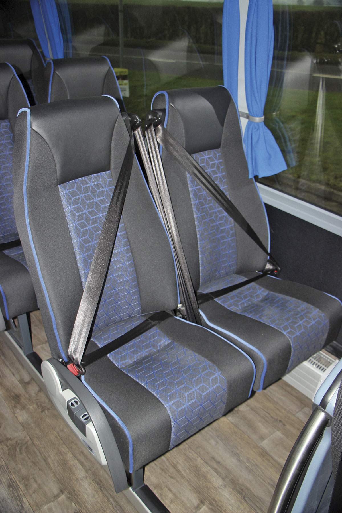 Vogel produce the Eco10 seats. Only the front and centre rear units have three-point belts