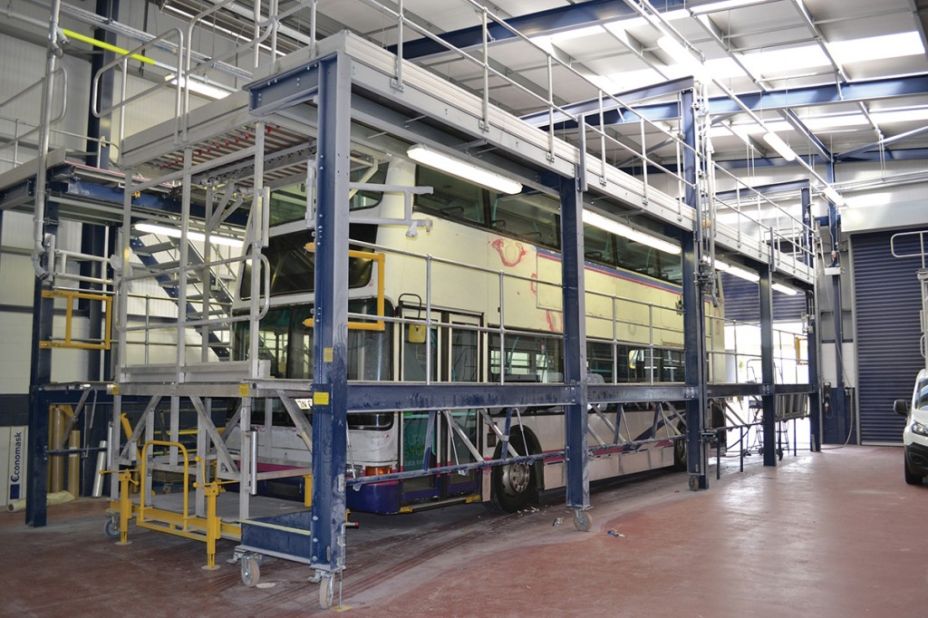 Prior to repainting, the bus will go into the preparation booth to be stripped of its livery.