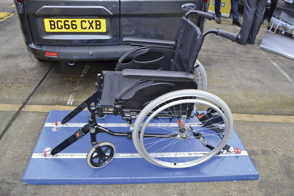 The Koller EXCEL 120. Combined wheelchair restraint is demonstrated here. Customers were encouraged to sit in the chair and test the stability