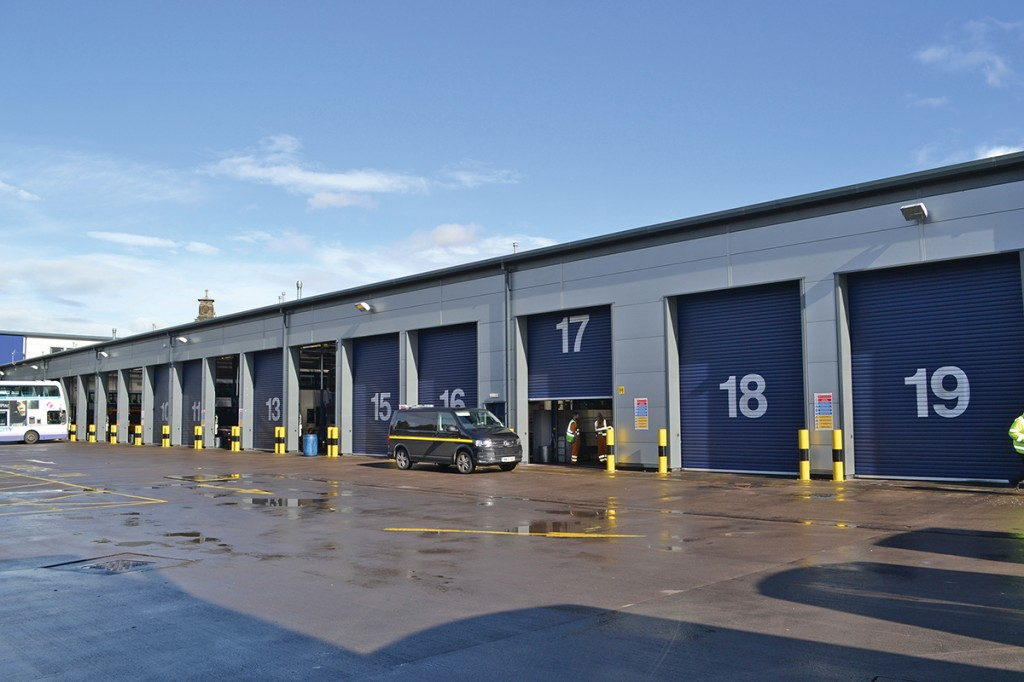 There are twenty bays on site, one of which is a specialist glass area. The van outside bay 16 is a roadside repair vehicle.