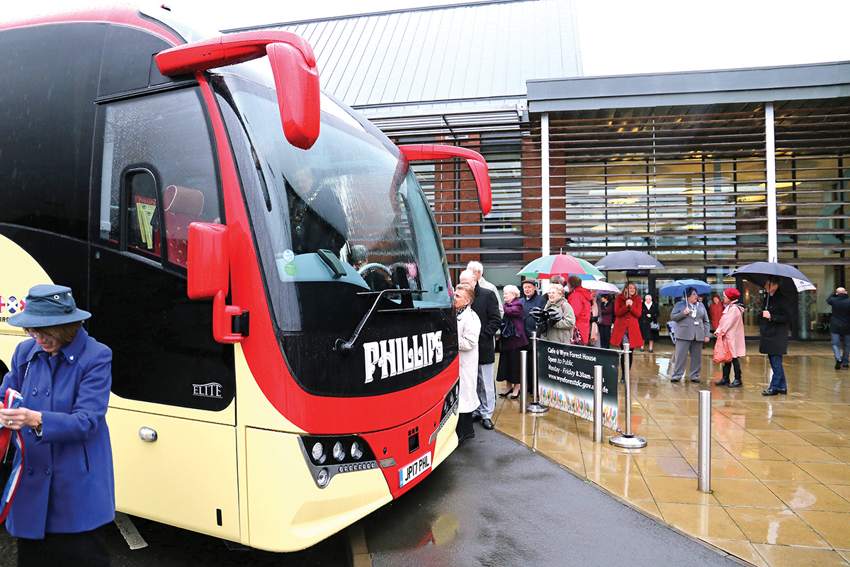 Customers queue to inspect the new coach.