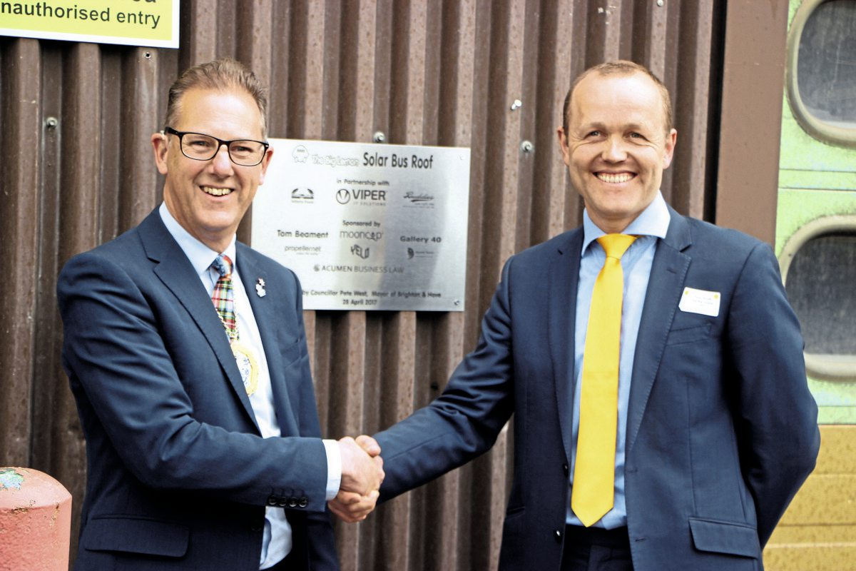 Brighton & Hove Mayor, Pete West in front of the plaque he and Tom Druitt unveiled celebrating the contribution of the company's partners and sponsors