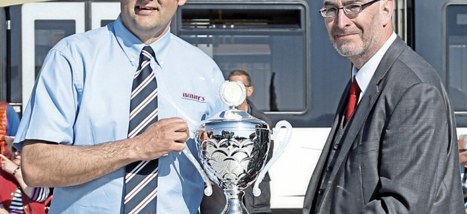 Chris Bibby receives the Coach Driver of the Year Trophy from Kevin Rooney