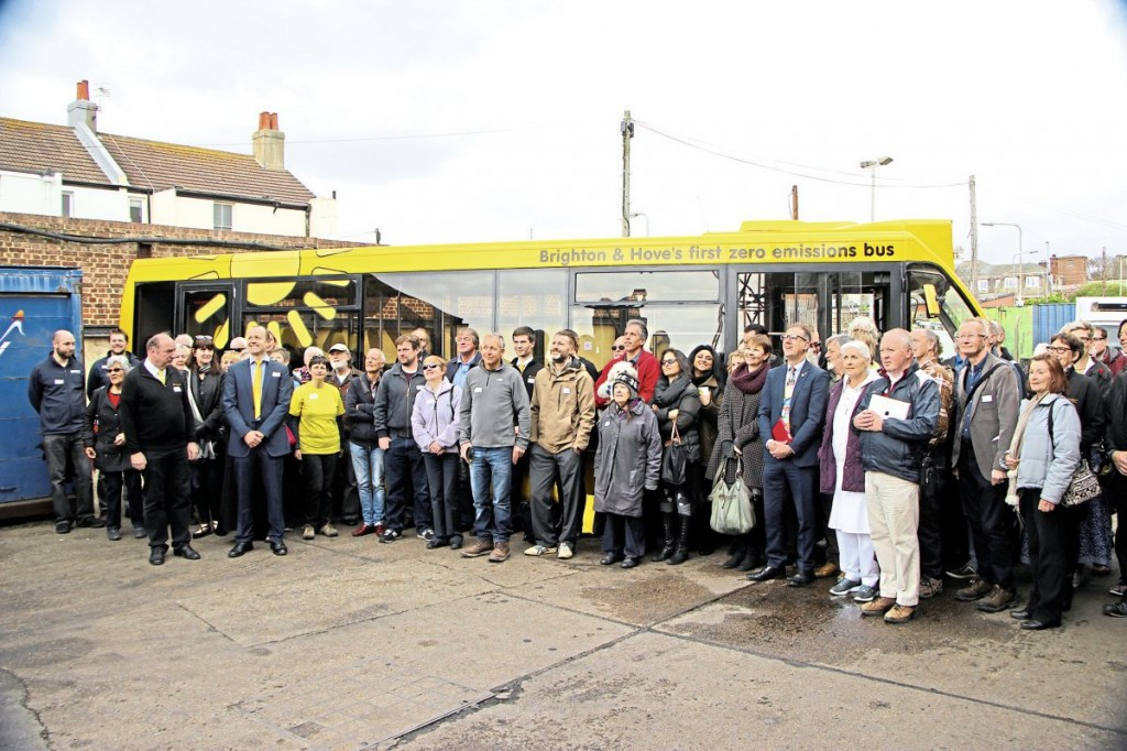 The solar powered bus, the Big Lemon team and some of their many guests celebrate the launch of the service