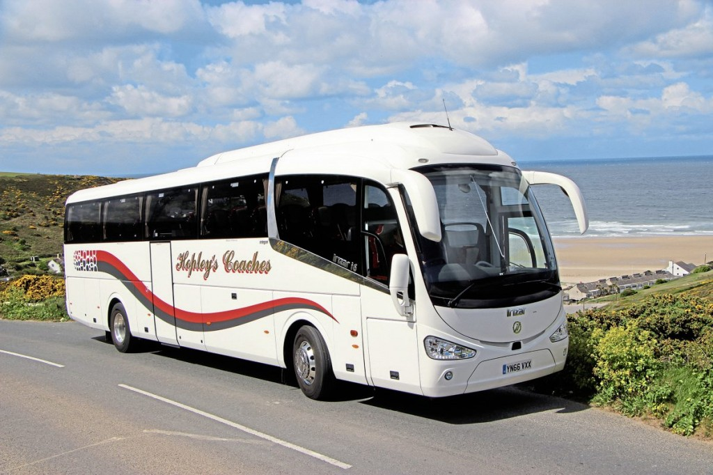 Hopley's new Irizar i6 integral with Porthtowan beach visible behind it