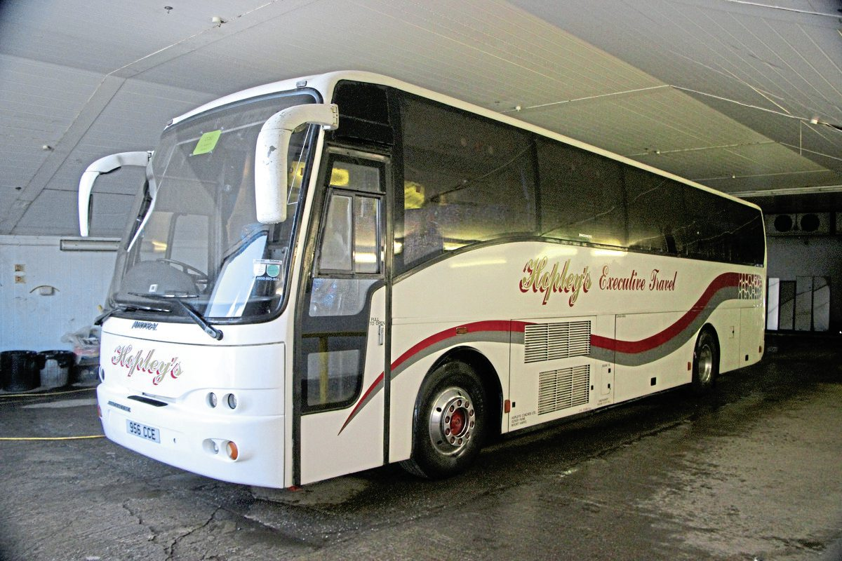 One of two late Volvo B10M Jonckheere Mistrals used on school work