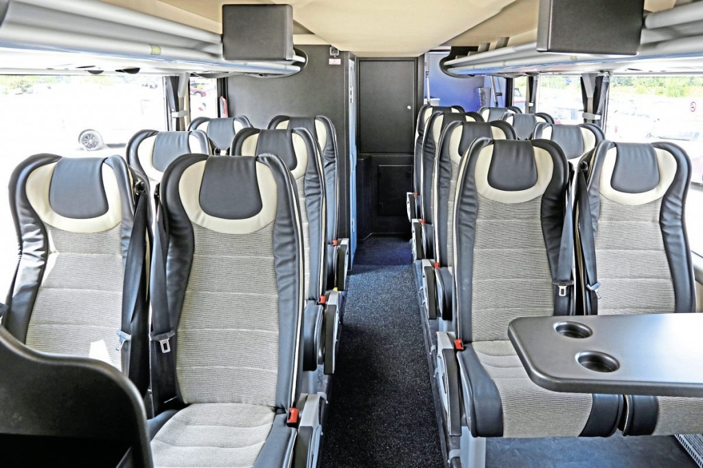 The lower deck with 16 MVT seats, toilet and two rack mounted monitors
