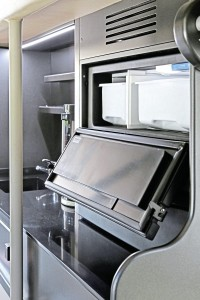 The servery area above the front offside wheel. There is a useful cupboard with 240V sockets on the opposite side