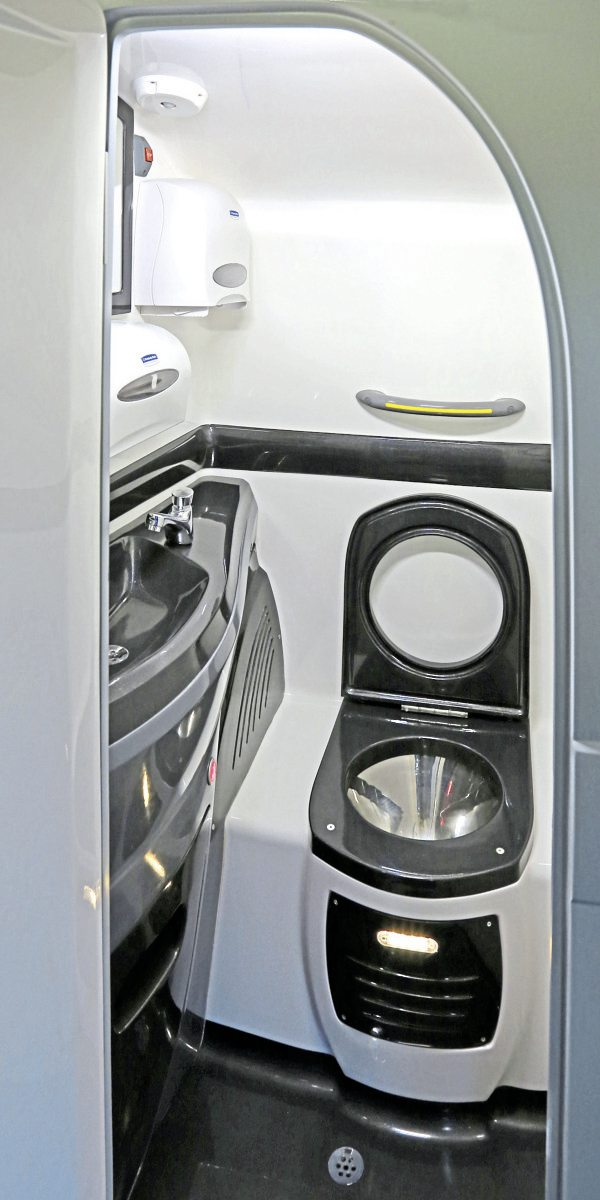 The toilet is mounted opposite the centre entrance on the lower deck-1