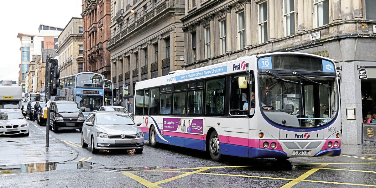 Traffic congestion has significantly reduced bus speeds in the centre of Glasgow. Vehicles edge their way down Renfield St