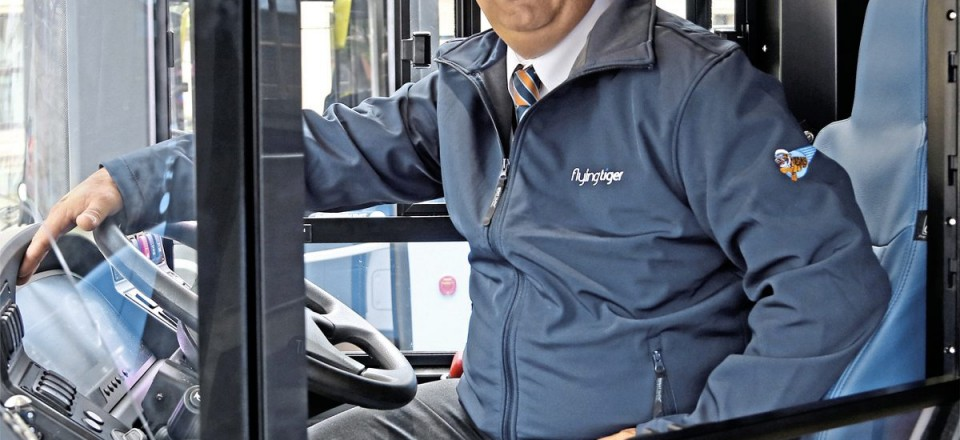 Depot supervisor at Idle, Nick Coleman, demonstrates the new uniform for Flying Tiger drivers