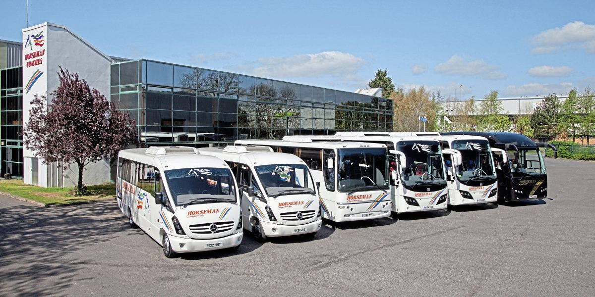 The depot and office block with a cross section of the Plaxton bodied coaches in the fleet in 2014, Cheetah, Profile, Panther and Elite