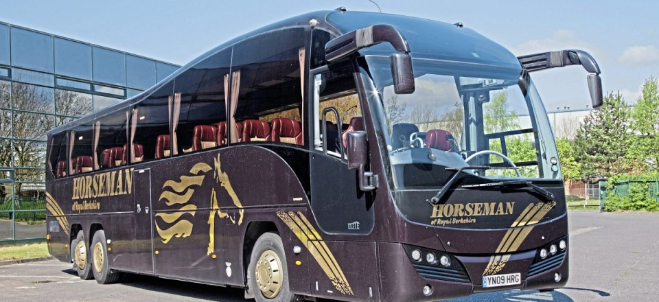 The three-axle high specification Plaxton Elite carries a distinctive livery with gold logos