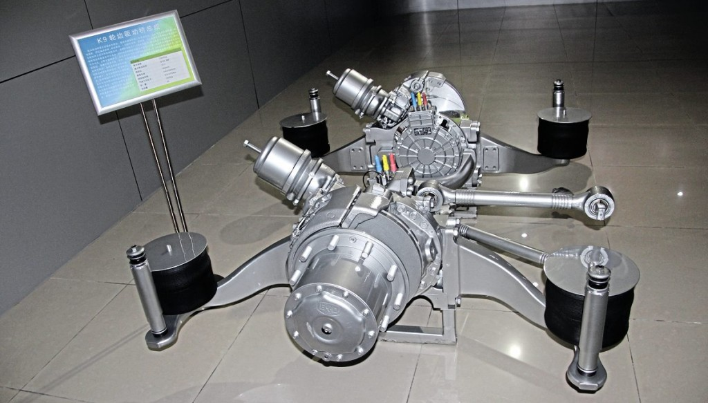 BYD's drive system has the liquid cooled traction motor and two-stage reduction gearing integrated within the wheel hubs of the axle, with no transmission shaft.