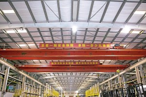 The slogans on the banner in the Prototype bus plant advise staff to, 'keep more precise attention to the working procedure and avoid any slight accident.'