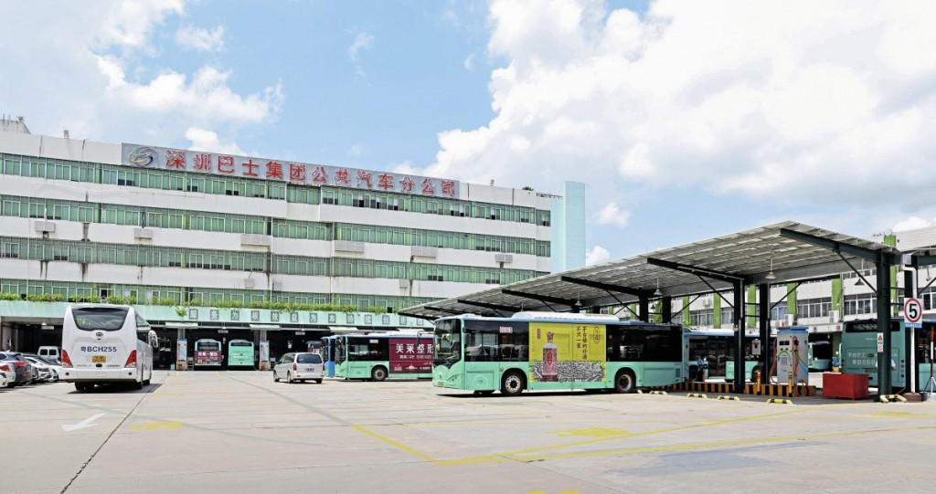 Shenzhen Bus Group's Xiang Meibei large depot with BYD buses charging beneath the solar-panelled roof of the charging station