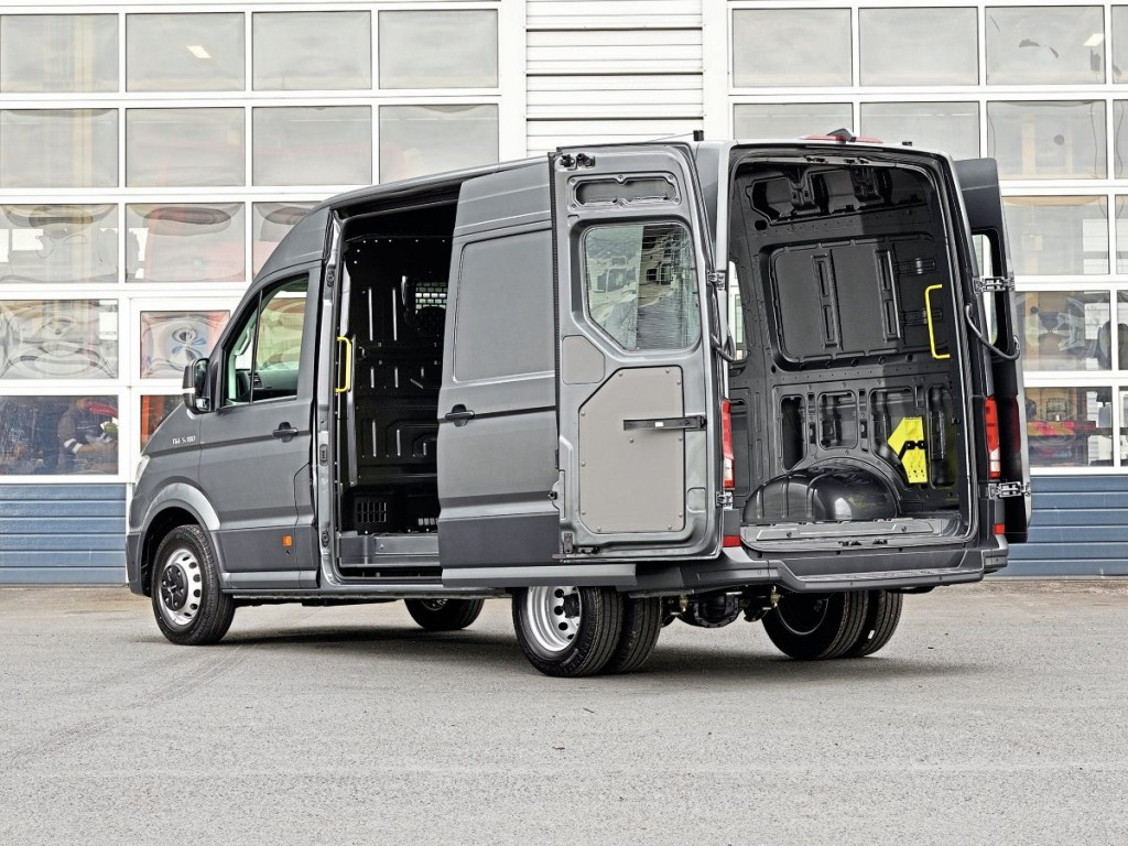 There is a sliding side door and fully opening rear doors