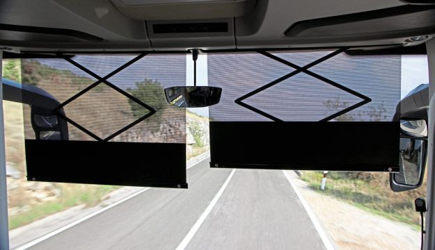 As a passenger, I hate blinds that block your view. Drivers should wear peaked caps, asserted one of my colleagues