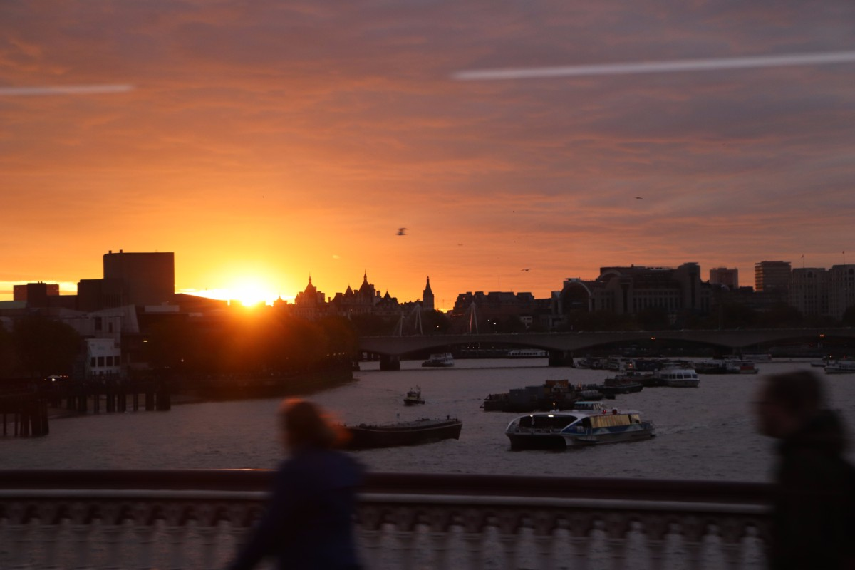 Looking back at the sun setting over Waterloo Bridge from a 388 crossing Blackfriars Bridge