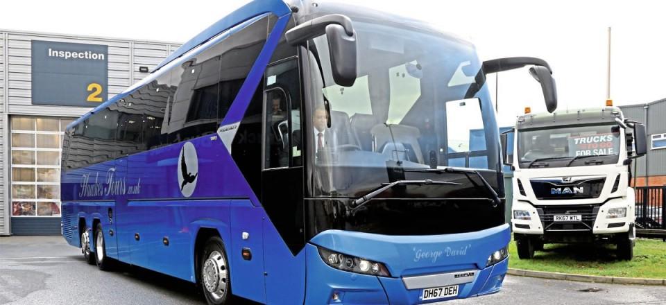 Hawkes Tours vehicles feature a distinctive blue fade colour scheme with a black on silver hawk motif