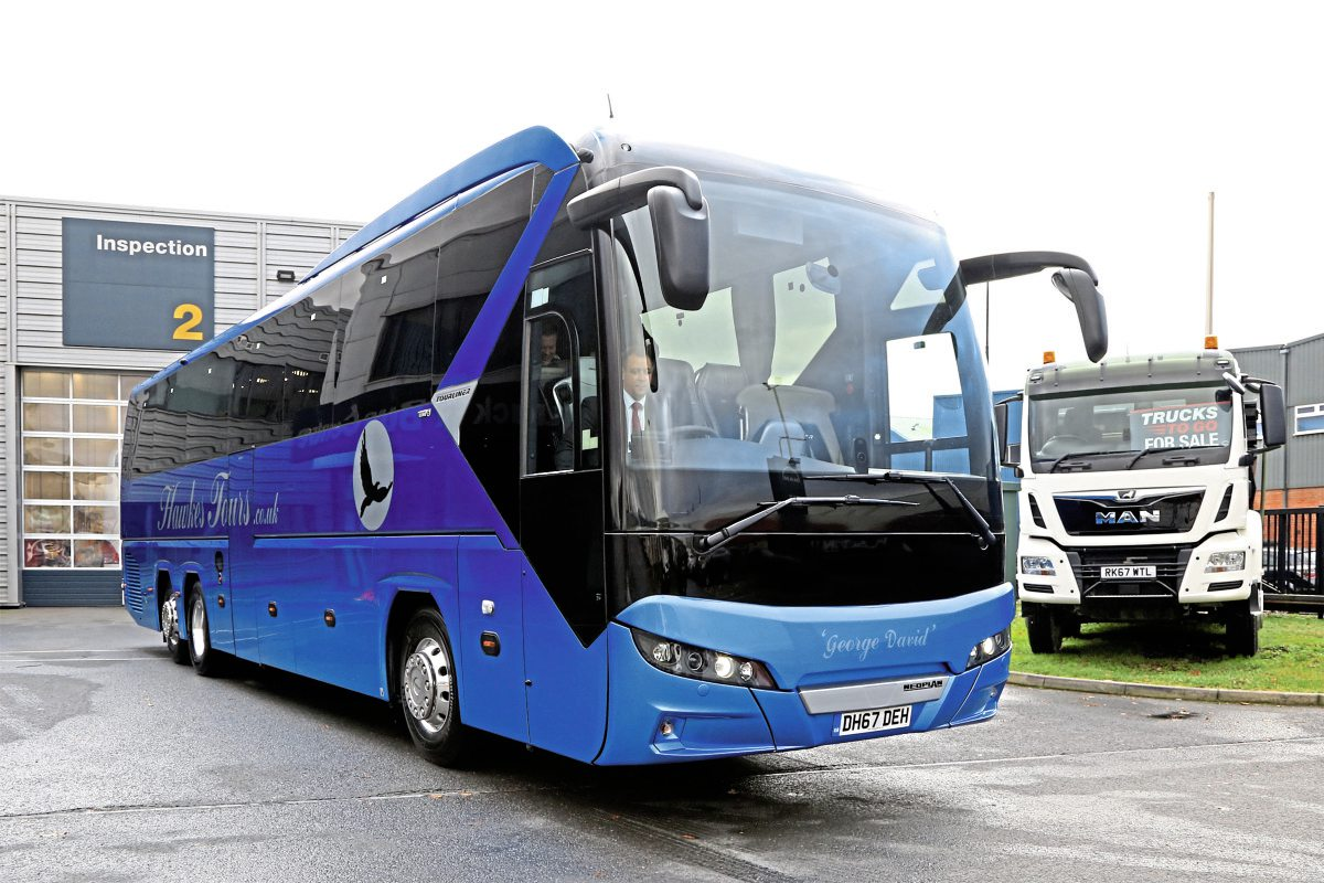 Hawkes Tours vehicles feature a distinctive blue fade colour scheme with a black on silver hawk motif
