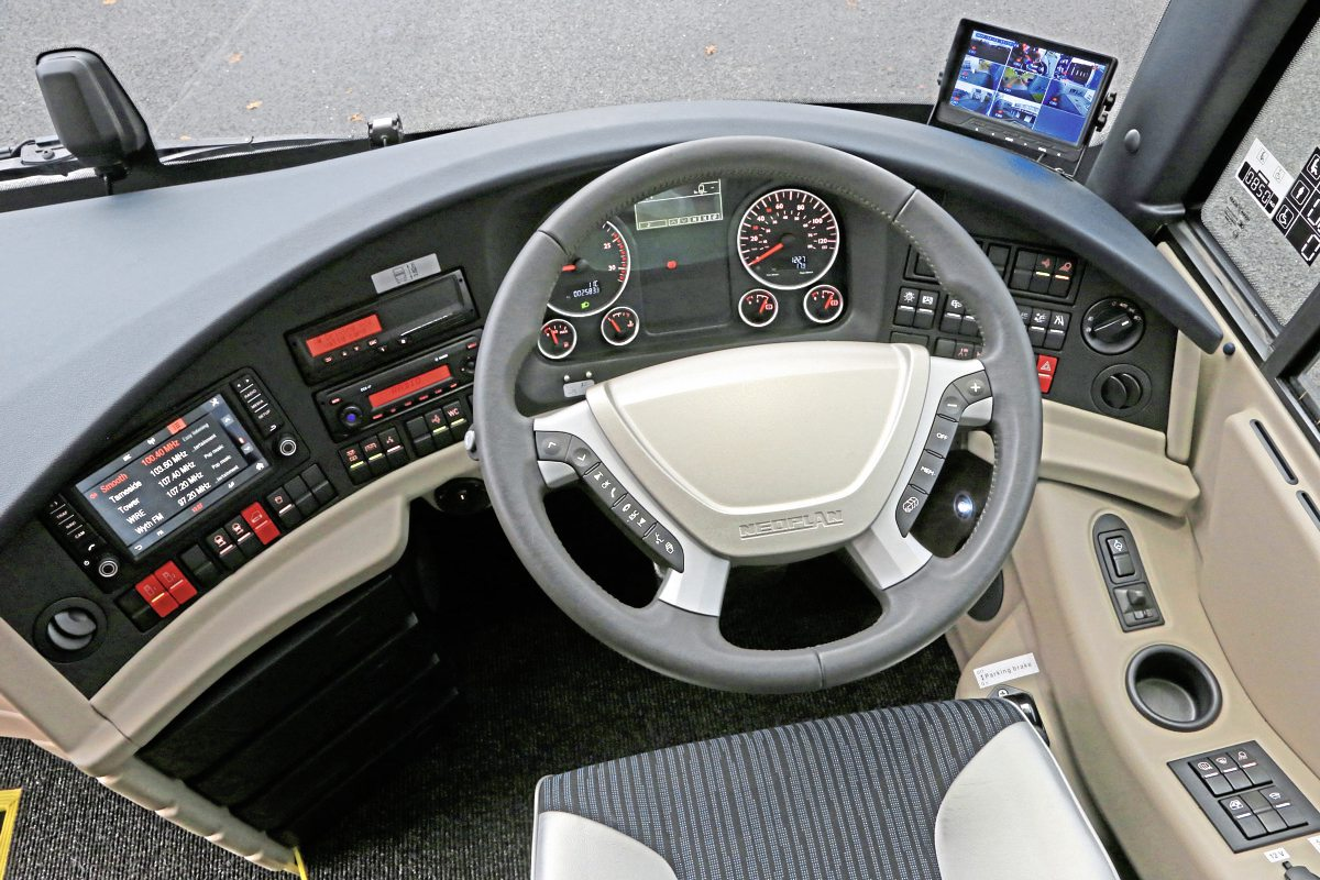 The new Tourliner dash with coloured displays together with the CCTV monitor added by AD Coach Systems