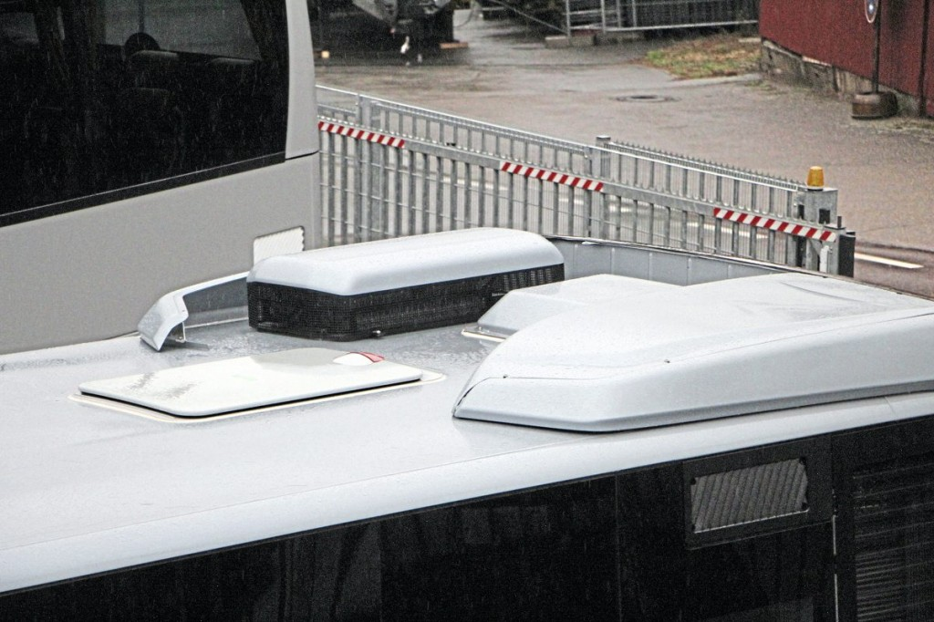 The super-capacitors are mounted within a silver topped black pod on the rear of the roof