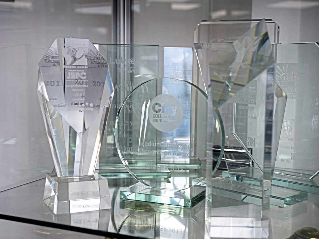 Glassware and trophies shown with pride in the waiting room include awards from National Express