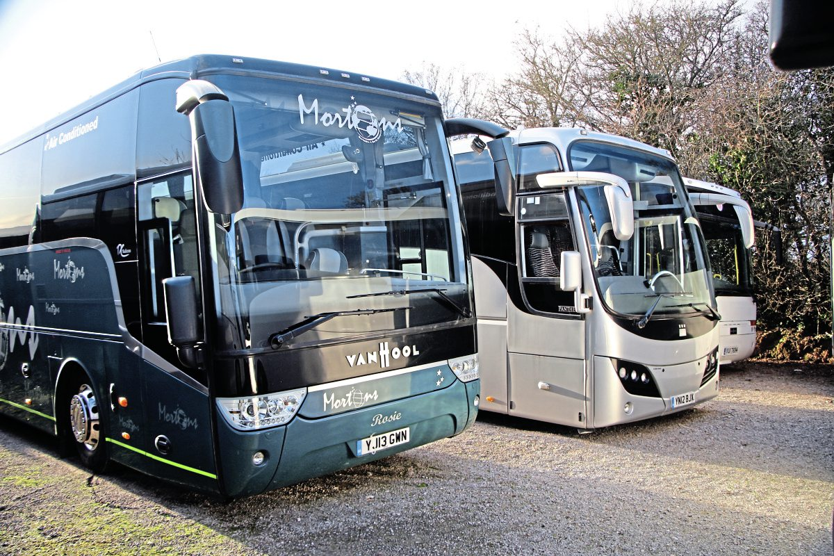 In the foreground, this DAF-powered 13-plate Van Hool TX16 Alicron, previously with Mortons, is one of his own.