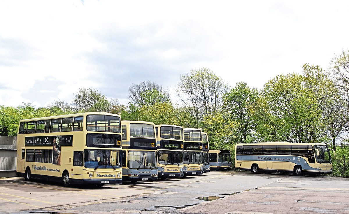 A line up of some of the vehicles used on the operator's school services, including a Dennis Trident 2 ALX400, two Dennis Trident based East Lancs Lolynes and two Volvo B7TL ALX400s. Also pictured is a Plaxton Panther bodied Volvo B12B and a Dennis Dart SLF with Pointer 2 bodywork