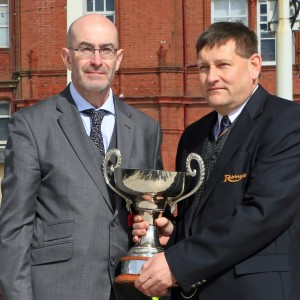 Billy Brayford of Robinsons collects his trophy from Traffic Commissioner Kevin Rooney