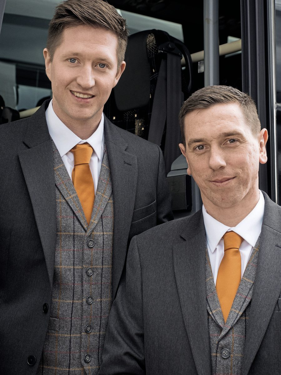 Mark Heritage, General Manager (left), and Willie Hamilton, Coaching and Touring Manager, will be at the helm of the new operation. At the UK Coach Rally, they wore the driver uniform jointly designed with Pride & Joy Clothing