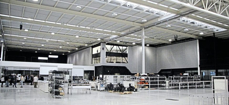 Offices are located in the corner of the facility. Ahead of them are component assembly areas