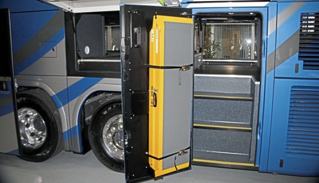 A full-height nearside door gives entry to the luggage compartment which has a capacity of 6.8 cubic metres. Note the access ramp stored on the door inner